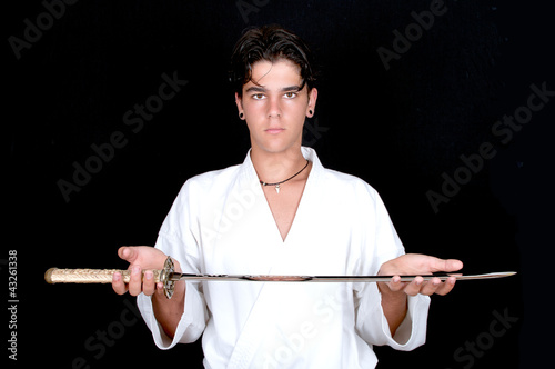 karate man offering a katana