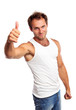 Portrait of a muscular young man, thumb up