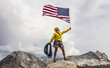 Climber raising the flag on the summit.