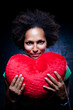 Afroamerican Woman with a Heart-Shaped Cushion