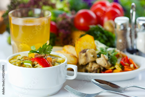 Business lunch with soup, salad and juice