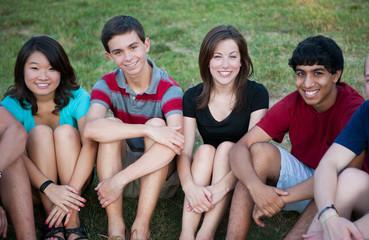 Group of Multi-ethnic happy teenagers outside