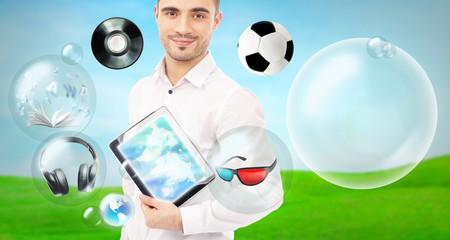Adult handsome man holding tablet computer. Icons of different o