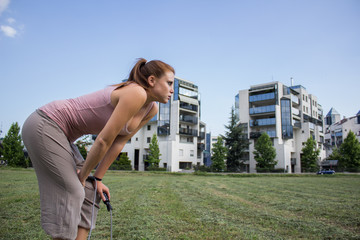 Sensual and tired girl keep fit in a urban landscape