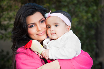 portrait of Indian mother with little baby girl in outdoors