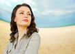Pretty woman standing at beautiful seaside background. Nature ca