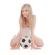 teenager sitting on floor with soccer ball over white