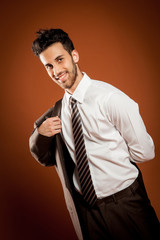 Smiling man wears a jacket