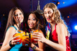 People drinking cocktails in bar or club