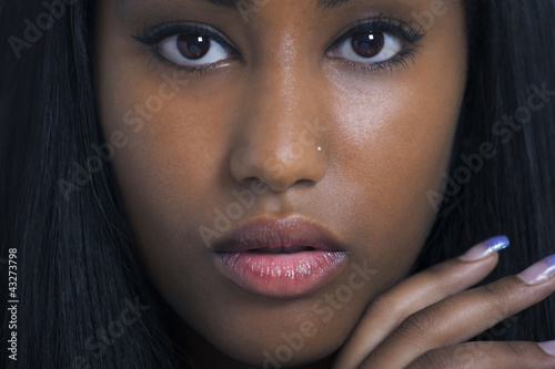 Lovely ethnic woman face closeup