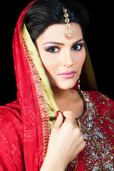 Indian bride wearing a red bridal dress