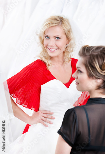 Future bride imagines herself in wedding gown, white background