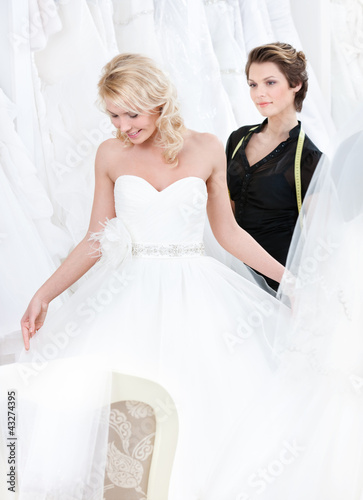 Girl admires the wedding dress that suits her