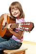 little girl playing classical guitar