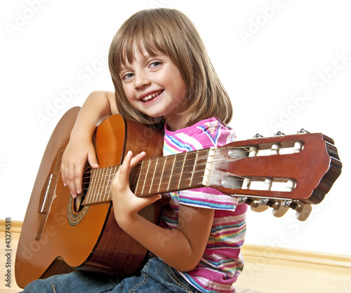 little girl playing guitar - white background