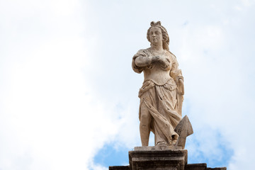 Woman rising above an anchor statue on top of St. Blaise church