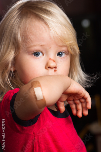 Injured boy with band aid on