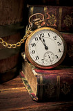 Fototapety Old pocket watch and books in Low-key