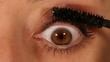 Eye expression closeup - rimmel, mascara application