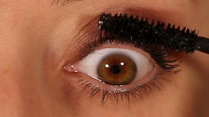 Eye expression closeup - rimmel, mascara application