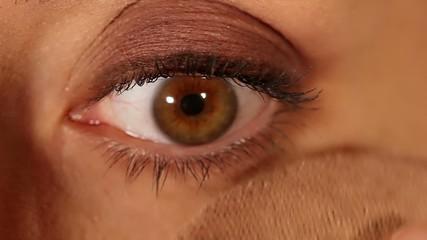 Female eye expression closeup - face powder application