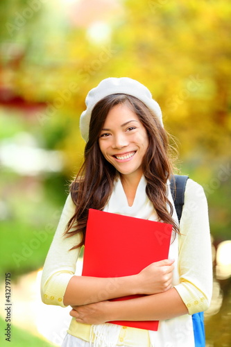 Young woman student in autumn park