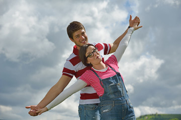 Portrait of romantic young couple smiling together outdoor