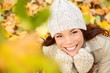 Autumn woman in yellow leaves portrait