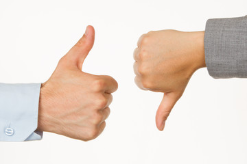 Caucasian business man and woman holding thumb up and down