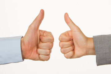 Caucasian business man and woman holding thumb up