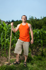 Young farmer near a corn field