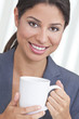 Happy Hispanic Woman Drinking Tea or Coffee