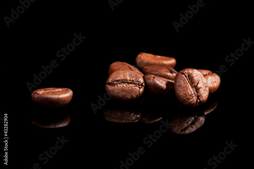 Luxurious coffee beans on black.