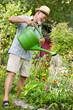 Watering the flowers in  the garden