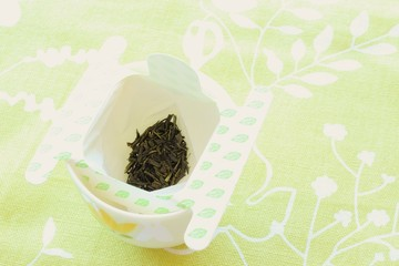 Green tea leaf in disposable tea filter