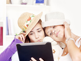 happy teenage girls having fun using touchpad computer