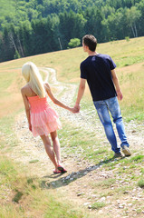 Young couple holding hand