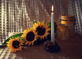 Still life with sunflowers and a candle