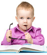 Cute little child play with book
