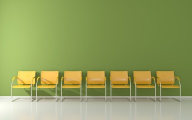 Yellow stools on green wall in the waiting room