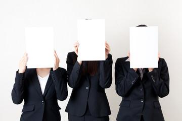 asian businesswomen holding a blank whiteboard