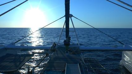 Catamaran, sailing to sunrise, Cuba
