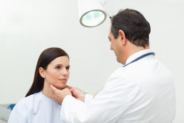 Doctor auscultating the neck of his patient
