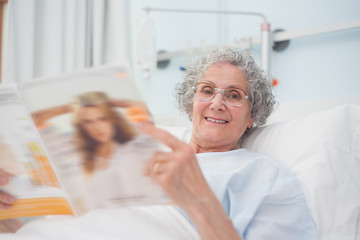 Elderly patient reading a magazine