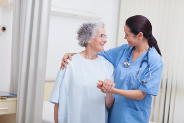 Nurse and a patient standing