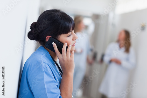 Nurse holding a mobile phone