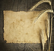wheat on the old wooden table and old paper