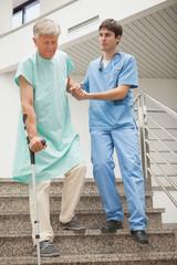 Male nurse assisting a patient