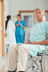 Patient in a wheelchair looking at camera