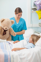 Nurse holding a teddy bear